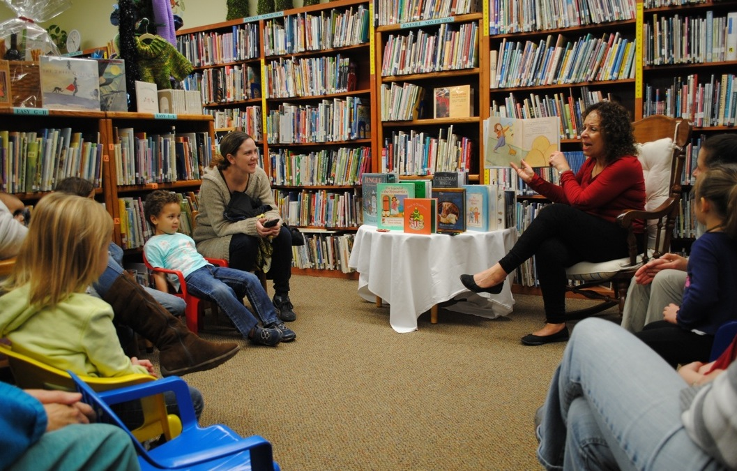 photo of Miss Annie reading stories to area children